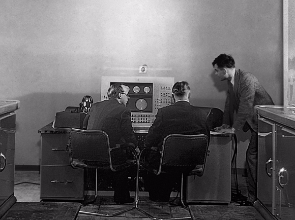 Alan Turing (right) at the console of the Mark II computer